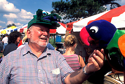Stock photo of a visitor to the Anhuac Texas Gatorfest looking over a festive souvenir.