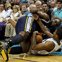 April 11, 2011; New Orleans, LA, USA; Utah Jazz center Al Jefferson (25) is called for a loose ball foul while diving to the floor with New Orleans Hornets small forward Trevor Ariza (1) during the first half at the New Orleans Arena.  Mandatory Credit: Derick E. Hingle