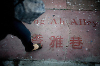 """Cynthia Yee leads a feng shui tour of Chinatown, through several alleyways, such as Hang Ah, or Pagoda Place, means """"fragrant"""" in Chinese, in San Francisco, Ca., on Friday, June 18, 2010."""