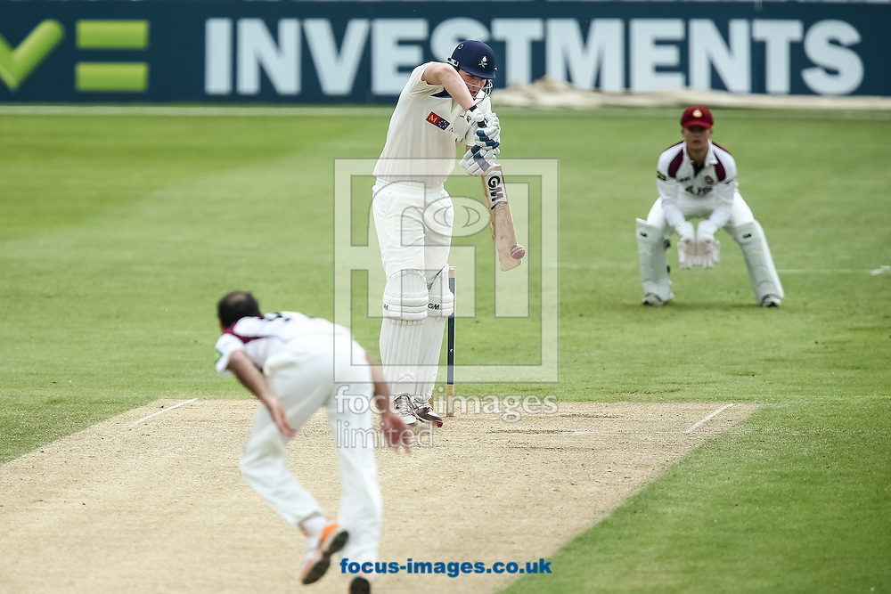 Alex Lees of Yorkshire County Cricket Club (centre) defends a ball from Muhammad Azhar Ullah of Northamptonshire County Cricket Club (left) during the LV County Championship Div One match at the County Ground, Northampton, Northampton<br /> Picture by Andy Kearns/Focus Images Ltd 0781 864 4264<br /> 01/06/2014