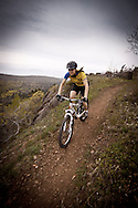 A female mountain biker rides the Woopidy Woo single track trail along Brockway Mountain in Copper Harbor Michigan.