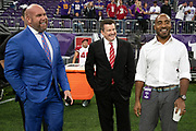 (L-R) Arizona Cardinals general manager Steve Keim, Arizona Cardinals team president Michael Bidwill, and sideline sports reporter Ronde Barber share a laugh on the sideline before the NFL week 6 regular season football game against the Minnesota Vikings on Sunday, Oct. 14, 2018 in Minneapolis. The Vikings won the game 27-17. (©Paul Anthony Spinelli)