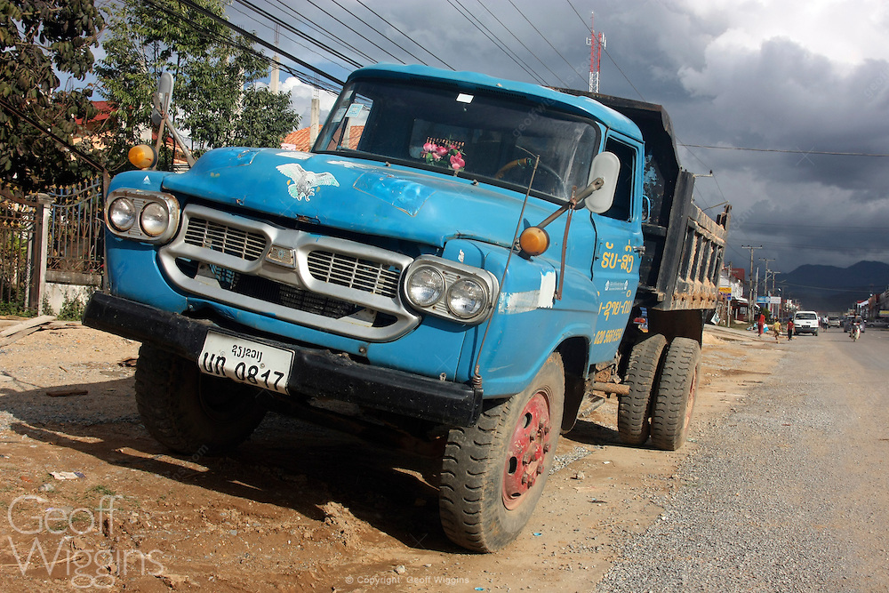 Vintage 1960s Isuzu dump truck at the roadside in Phonsovan, northern Laos