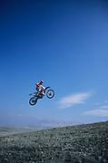 Man jumping on motorbike
