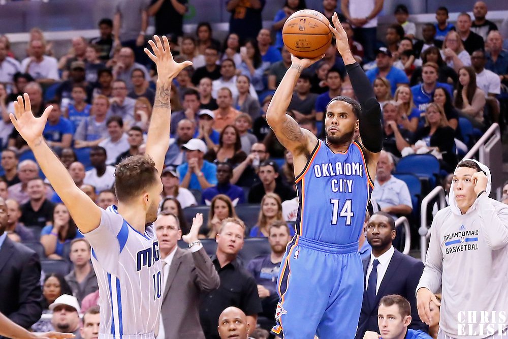 30 October 2015: Oklahoma City Thunder guard D.J. Augustin (14) takes a jump shot over Orlando Magic guard Evan Fournier (10) during the Oklahoma City Thunder 139-136 double overtime victory over the Orlando Magic, at the Amway Center, in Orlando, Florida, USA.