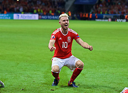 LILLE, FRANCE - Friday, July 1, 2016: Wales' Aaron Ramsey celebrates after a 3-1 victory over Belgium and reaching the Semi-Final during the UEFA Euro 2016 Championship Quarter-Final match at the Stade Pierre Mauroy. (Pic by David Rawcliffe/Propaganda)