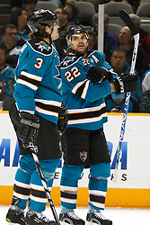 November 9, 2010; San Jose, CA, USA;  San Jose Sharks defenseman Dan Boyle (22) talks with defenseman Douglas Murray (3) during the first period against the Anaheim Ducks at HP Pavilion.  The Ducks defeated the Sharks 3-2 in overtime. Mandatory Credit: Jason O. Watson / US PRESSWIRE