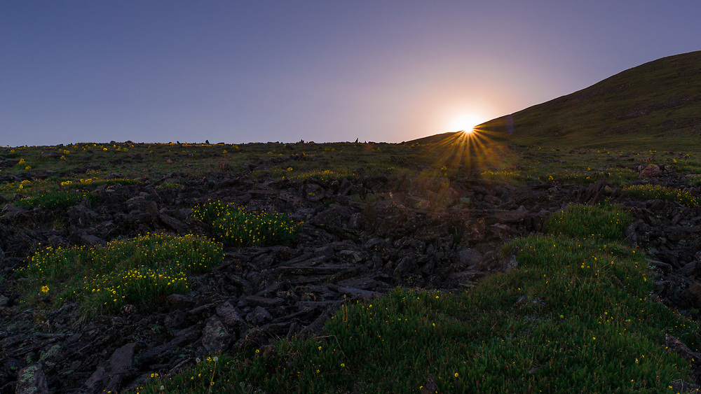 This picture was taken of the sunset on the mountain tundra in Colorado.<br /> <br /> Camera <br /> NIKON D610<br /> Lens <br /> TAMRON SP 24-70mm F2.8 Di VC USD A007N<br /> Focal Length <br /> 26<br /> Shutter Speed <br /> 1/640<br /> Aperture <br /> 14<br /> ISO <br /> 200