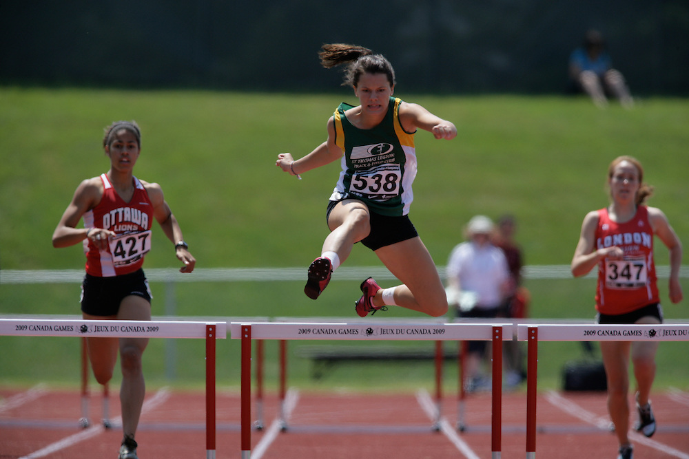(Charlottetown, Prince Edward Island -- 20090719) Jenessa Olson of ST Thomas Legion Tfc competes in the 400m hurdles final at the 2009 Canadian Junior Track & Field Championships at UPEI Alumni Canada Games Place on the campus of the University of Prince Edward Island, July 17-19, 2009.  Copyright Sean Burges / Mundo Sport Images , 2009.