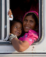 A woman and her son looking out  bus window in Jodhpur, Rajasthan, India