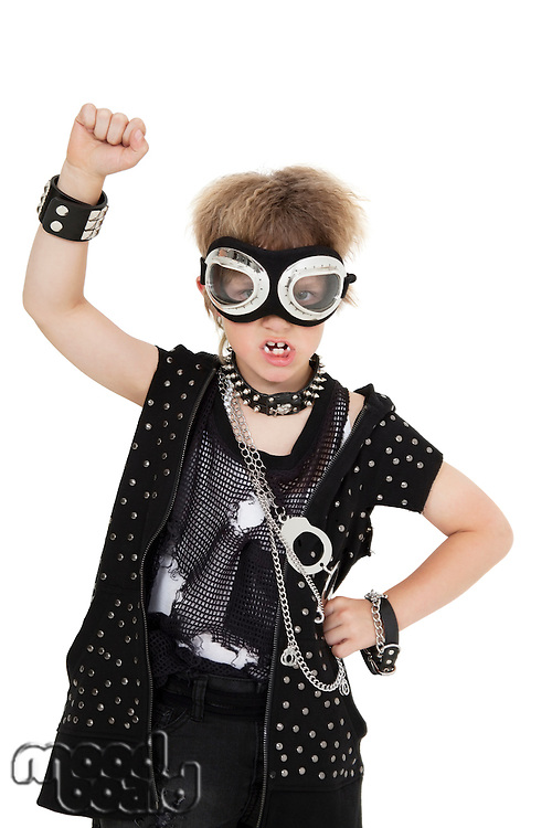 Portrait of enthusiastic punk boy wearing pilot goggles over white background