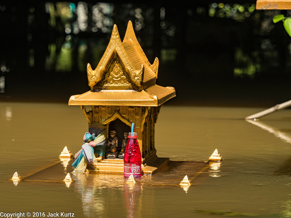 30 SEPTEMBER 2016 - SAI NOI, AYUTTHAYA, THAILAND: A spirit house nearly under water in Sai Noi, a village flooded by the Chao Phraya River. Spirit houses are normally 1.5 - 2 meters above the ground. The Chao Phraya River, the largest river that runs through central Thailand, has hit flood stage in several areas in Ayutthaya and Ang Thong provinces. Villages along the river are flooded and farms are losing their crops due to the flood. This is the same area that was devastated by floods in 2011, but the floods this year are not expected to be as severe. The floods are being fed by water released from upstream dams. The water is being released to make room for heavy rains expected in October.      PHOTO BY JACK KURTZ