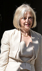Image ©Licensed to i-Images Picture Agency. 10/06/2014. <br />  <br /> Theresa May leaves a cabinet Meeting at 10 Downing Street, London, UK. Wednesday 10th of June 2014<br /> <br /> Picture by Ben Stevens / i-Images