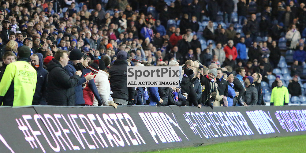 Fans had to come on to the side of park due to the stadium as bits of the roof came down  during the Rangers v Dumbarton  Scottish Championship  1 December 2015 <br /> <br /> (c) Andy Scott | SportPix.org.uk