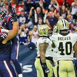Nov 29, 2015; Houston, TX, USA; Houston Texans quarterback Brian Hoyer (7) celebrates a touchdown with guard Brandon Brooks (79) during the second half of a game against the New Orleans Saints at NRG Stadium. The Texans defeated the Saints 24-6. Mandatory Credit: Derick E. Hingle-USA TODAY Sports