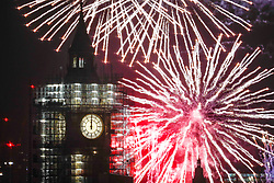 © Licensed to London News Pictures. 01/01/2018. London, UK. Fireworks on the Thames by Parliament and Big Ben herald the start of the New Year in 2018. Photo credit: Peter Macdiarmid/LNP