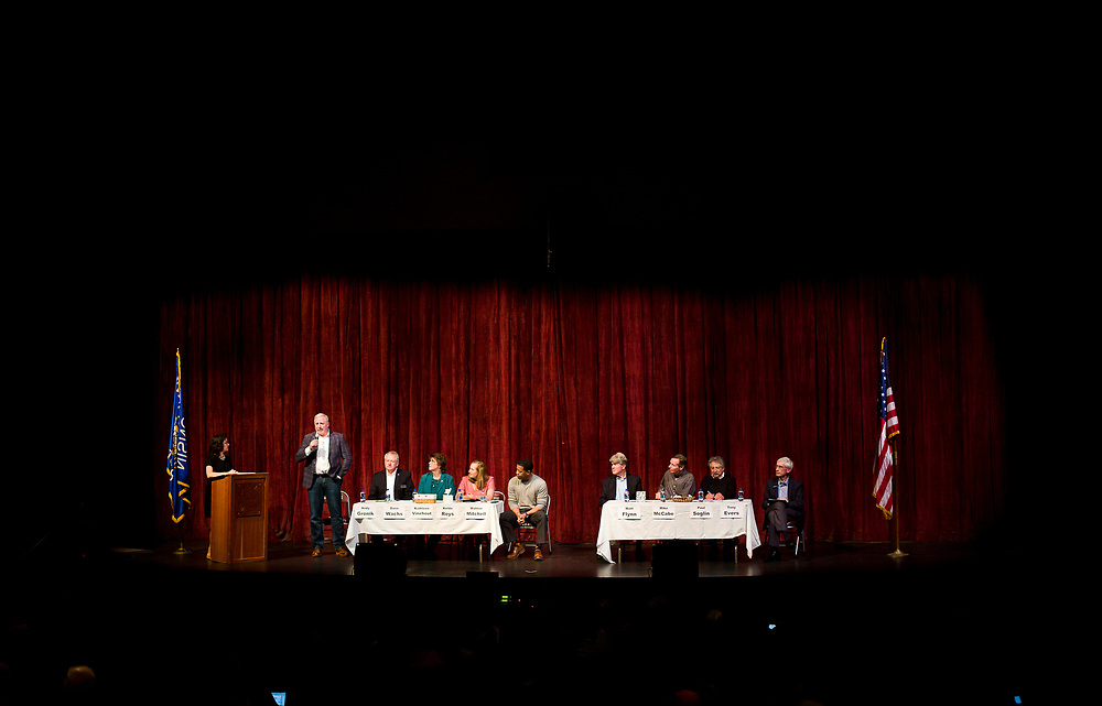 Andy Gronik, left, speaks during the public forum for Democratic gubernatorial candidates at LaFollete High School in Monona, Wisconsin., Sunday, Jan. 28, 2018.