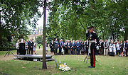 UNITED KINGDOM, London: 7 July 2015 A member of the British army lays a wreath and salutes as Friends and family of the victims of the July the 7th bombing in London pay there respects on the ten year anniversary at Russell Square in London, England. Andrew Cowie / Story Picture Agency