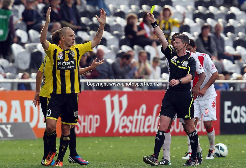 Stein Huysegems of the Phoenix is shown the yellow card by referee Brent Hayward.<br /> A-League, Wellington Phoenix v Melbourne Heart, 3 March 2013, Forsyth Barr Stadium, Dunedin, New Zealand.<br /> Photo: Rob Jefferies / photosport.co.nz