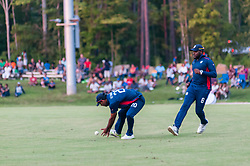 September 22, 2018 - Morrisville, North Carolina, US - Sept. 22, 2018 - Morrisville N.C., USA - Team USA SAURABH NETRAVALKAR (20) fields the ball as STEVEN TAYLOR (8) backs him up during the ICC World T20 America's ''A'' Qualifier cricket match between USA and Canada. Both teams played to a 140/8 tie with Canada winning the Super Over for the overall win. In addition to USA and Canada, the ICC World T20 America's ''A'' Qualifier also features Belize and Panama in the six-day tournament that ends Sept. 26. (Credit Image: © Timothy L. Hale/ZUMA Wire)