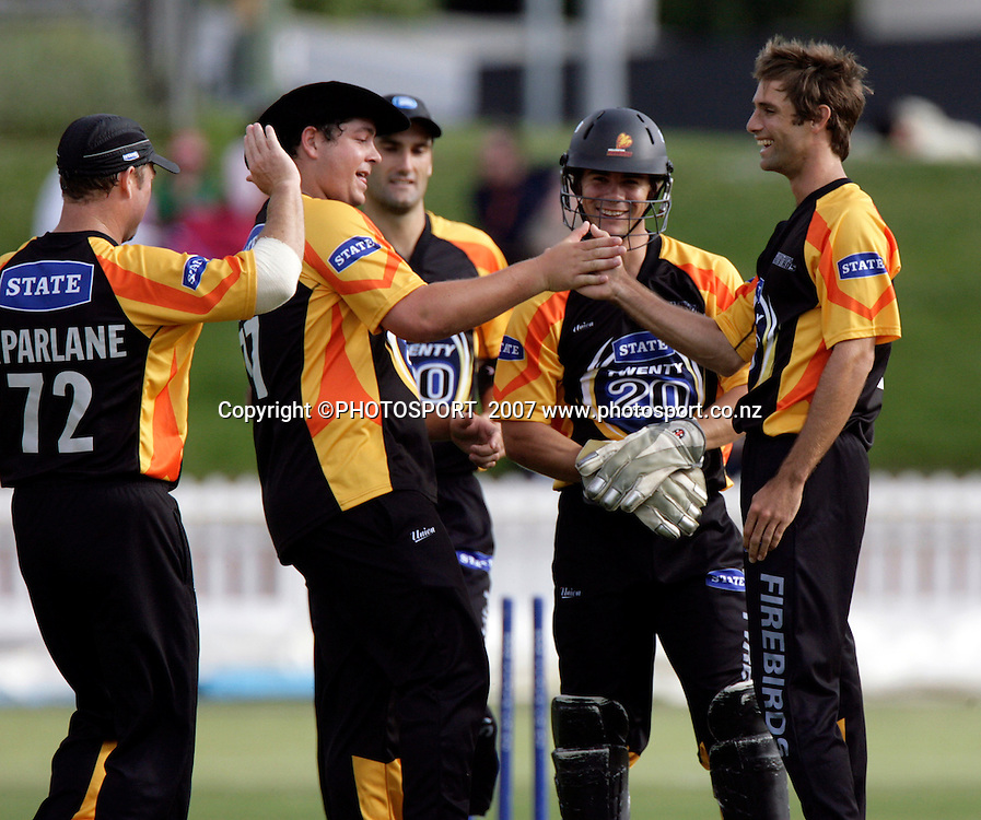 The Firebirds celebrate after the Knights Bruce Martin was stumped in Twenty20 cricket action between the Northern Knights and Wellington Firebirds at the Basin Reserve, Wellington, Friday 19 January, 2007.    Photo:  Anthony Phelps/PHOTOSPORT