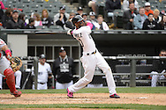 CHICAGO - MAY 10:  Alexei Ramirez #10 of the Chicago White Sox bats against the Cincinnati Red on May 10, 2015 at U.S. Cellular Field in Chicago, Illinois.  (Photo by Ron Vesely)   Subject:   Alexei Ramirez