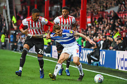 Queens Park Rangers Midfielder Luke Freeman (7) and Brentford Defender Ezri Konsa Ngoyo (26) battle for the ball during the EFL Sky Bet Championship match between Brentford and Queens Park Rangers at Griffin Park, London, England on 2 March 2019.