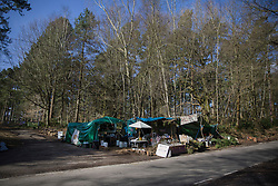 © Licensed to London News Pictures. 02/03/2017. Coldharbour, UK. Protestors occupy a road side area near the 'Protection Camp' on Leith Hill. Activists have constructed and occupied a fort and some trees on the site of a proposed oil well. Planning permission for 18 weeks of exploratory drilling was granted to Europa Oil and Gas in August 2015 after a four-year planning battle. The camp was set up by protestors in October 2016 in order to draw  attention to plans to drill in this Area of Outstanding Natural Beauty (AONB) in the Surrey Hills. The camp has received support from the local community.  Photo credit: Peter Macdiarmid/LNP