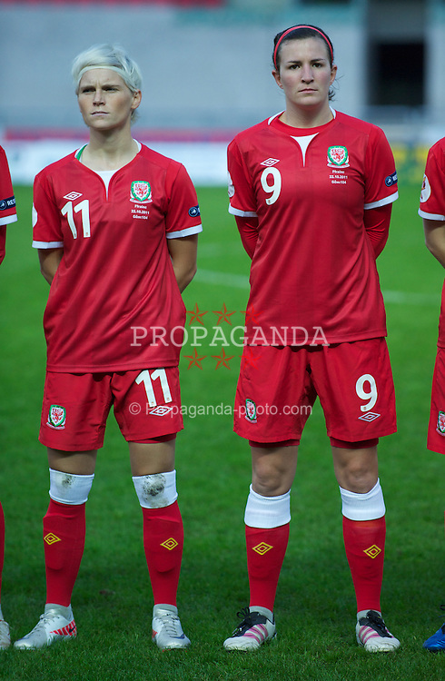 LLANELLI, WALES - Saturday, October 22, 2011: Wales' Jessica Fishlock and Helen Lander line-up before the UEFA Women's EURO 2013 Qualifying Group 4 match against France at Parc Y Scarlets. (Pic by Gareth Davies/Propaganda)