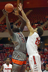 17 December 2014: Arkeem Joseph looses the ball on a shot as he is fouled by Reggie Lynch during an NCAA Men's Basketball game between the Skyhawks of University of Tennessee - Martin and the Redbirds of Illinois State at Redbird Arena in Normal Illinois
