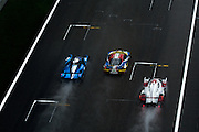 29th October - 1st November 2015. World Endurance Championship. 6 Hours of Shanghai. Shanghai International Circuit, China. Racing action between an Audi, Ferrari and LMP2 car