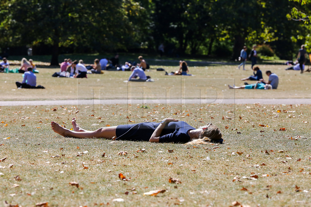 © Licensed to London News Pictures. 13/09/2019. London, UK. A woman sunbathes in St James's Park on a warm and sunny day in the capital. According to the Met Office, the temperature is likely to reach 25 degrees celsius this weekend in many parts of UK. Photo credit: Dinendra Haria/LNP