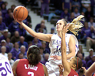 Kansas State guard Claire Coggins (14) drives the lane and scores past Oklahoma's Britney Brown (lower right) and Courtney Paris (lower left), during the second half at Bramlage Coliseum in Manhattan, Kansas, February 21, 2006.  The 9th ranked Sooners defeated K-State 78-64.