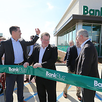Brent Waldrop, center left, and Tupelo Mayor Jason Shelton prepare to cut the ribbon to offically open Bank Plus' newest location on North Gloster Street.