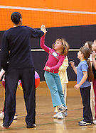 Middletown, N.Y. - A 7-year-old girl leaps to give a high five to one of her team's leaders at the volleyball station during National Women in Sports Day on Feb. 11, 2006. Orange County Community College's Department of Movement Science celebrated the 20th Anniversary of National Girls and Women in Sports Day by holding an event for young girls that included volleyball, basketball, soccer, games and swimming.