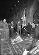 Remembrance Day Service.1983.13.11.1983.11.13.1983.13th November 1983..A remembrance service was held in St Patrick's Cathederal, Dublin,(Poppy Day) to commerate the Irish Fallen who died  whilst on service with the British Army in the two World Wars..Photo of an upstanding congregation as the colours,An Irish Army flag and the flags of the Royal British Legion,are trooped to the altar..Brig.-Gen.,Gerry O'Sullivan,G.O.C. Eastern Command is to the left in the picture.