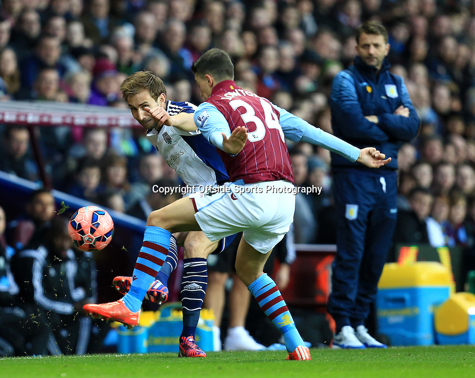 7th March 2015 - FA Cup 6th Round - Aston Villa v West Bromwich Albion - Craig Dawson of West Bromwich Albion slips a ball past  Matthew Lowton of Aston Villa - Photo: Paul Roberts / Offside.