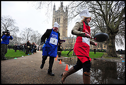 Sky news Sophy Ridge and Lord Kennedy of Southwark  take part in the MP's and Lords race against political Journalist in the Rehab Parliamentary Pancake Shrove Tuesday race a charity event which sees MPs and Lords joined by media types in a race to the finish. Victoria Tower Gardens, Westminster, Tuesday February 12, 2013. Photo By Andrew Parsons / i-Images