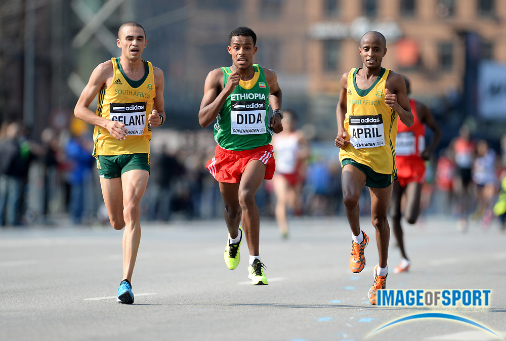 Mar 29, 2014; Copenhagen, Denmark; Elroy Gelant (RSA), Bonsa Dida (ETH) and Lusapho April (RSA) place 13th, 14th and 15th in the mens race in the IAAF/AL-Bank World Half Marathon Championship. Photo by Jiro Mochizuki