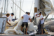 Crew preparing a spinnaker on Kalikobass II at the Superyacht Cup Regatta.