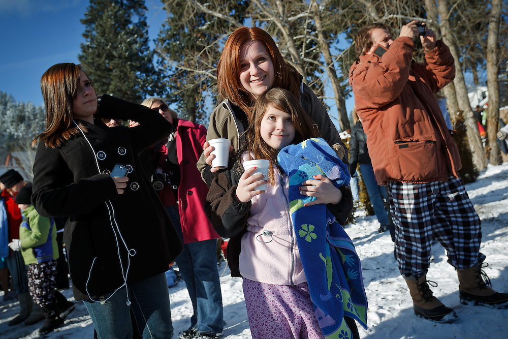 Marie and Rheana Pollos enjoy a hot chocoloate before participating in the Polar Bear Plunge on New Year's Day 2011 at Sanders Beach in Coeur d'Alene, Idaho.