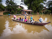 16 JUNE 2015 - SUNGAI KOLOK, THAILAND:  A boat makes the short crossing from Malaysia to Thailand. The border between Thailand and Malaysia in Sungai Kolok, Narathiwat, Thailand. Thai and Malaysians cross the border freely for shopping and family visits. The border here is the Kolok River (Sungai is the Malay word for river).        PHOTO BY JACK KURTZ