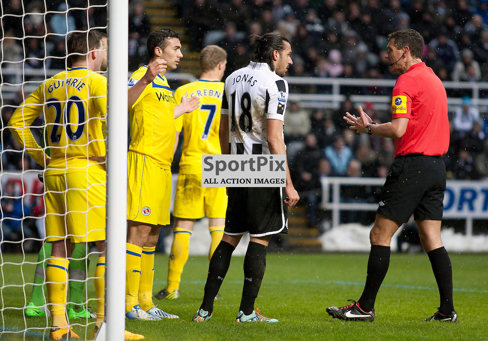 Referee Andre Marriner has words with the Reading defence. Newcastle Utd v Reading FC. English Premiership, St James' Park, 19 January 2013 (c) Russell Sneddon | Stockpix.eu