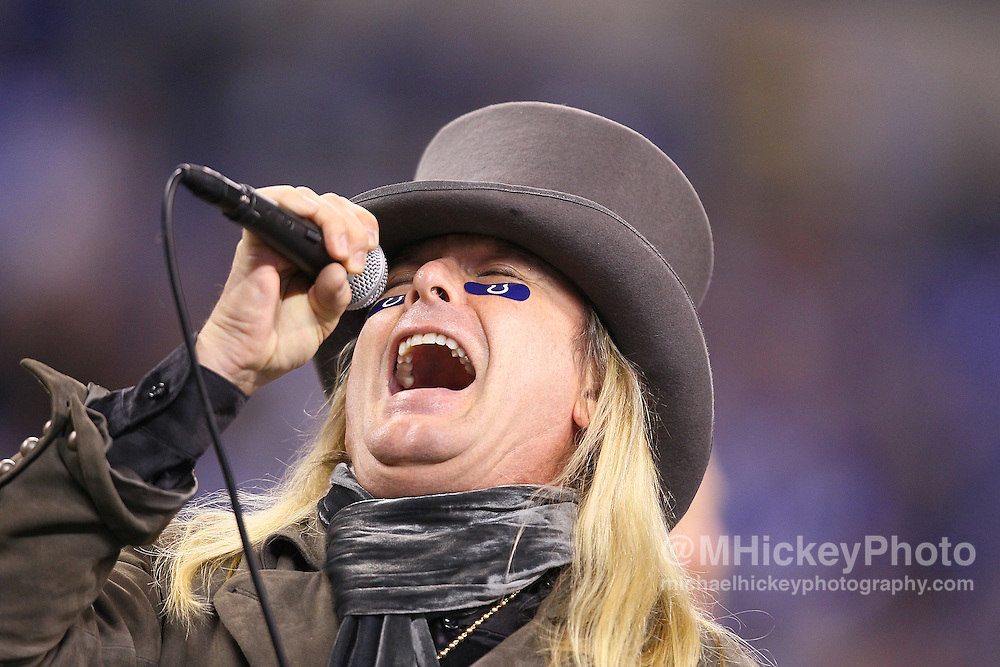 Jan. 08, 2011; Indianapolis, IN, USA; Robin Zander lead singer of the band Cheap Trick performs at halftime between the Indianapolis Colts and the New York Jets during the 2011 AFC wild card playoff at Lucas Oil Stadium. Mandatory credit: Michael Hickey-US PRESSWIRE