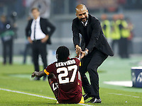 Uefa Champions League-2014-2015 / Group E / <br /> As Roma vs Fc Bayern Munich 1-7  ( Olympic Stadium, Roma - Italy ) <br /> The Coach of Fc Bayern Munich - Josep &quot; Pep &quot; Guardiola (R) , helps the player of As Roma Gervinho to get up ,<br /> during the match between As Roma and Fc Bayern Munich