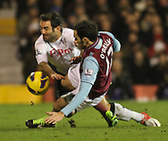 Picture by David Horn/Focus Images Ltd +44 7545 970036.30/01/2013.Giorgios Karagounis of Fulham is tackled by Joey O'Brien of West Ham United during the Barclays Premier League match at Craven Cottage, London.