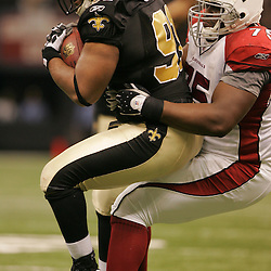 16 January 2010: New Orleans Saints defensive end Will Smith (91) is tackled by Arizona Cardinals offensive tackle Levi Brown (75) as he runs back an interception during a 45-14 win by the New Orleans Saints over the Arizona Cardinals in a 2010 NFC Divisional Playoff game at the Louisiana Superdome in New Orleans, Louisiana.