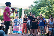 Ohio University community members participate in a vigil on College Green as a show of solidarity with the City of Orlando and the LGBTQ community near and far. Photo by Ben Siegel