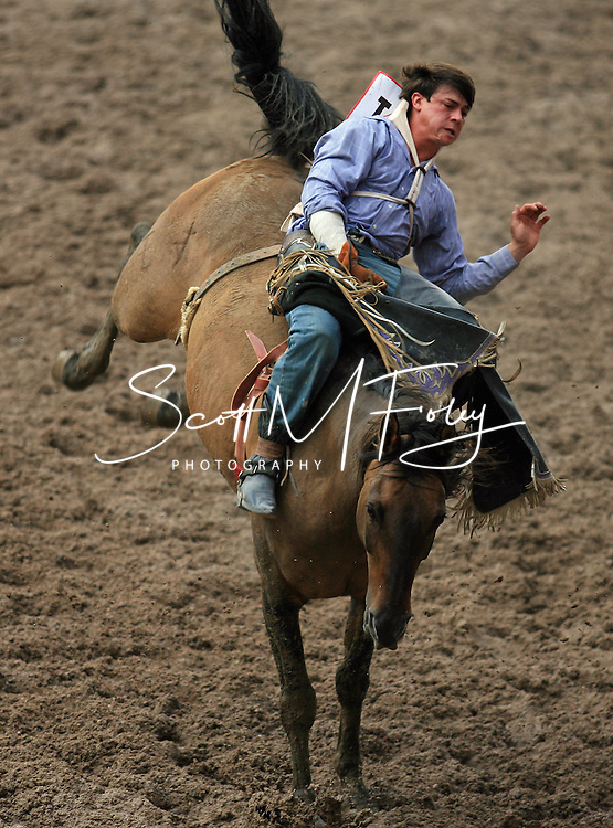 Bareback Rider David B Ross earns a 67 while riding M2 Moon Beam BR, 28 July 2007, Cheyenne Frontier Days