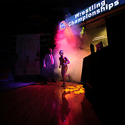 Kris Wilson/News Tribune<br /> MSHSAA official Lou Mazzacco holds the curtain open as Marceline's Clayton Stallo runs through the fog and lights during wrestler introductions prior to his Class 1 126-pound championship match with Romelle Person of Maplewood-Richmond Heights during the 2016 MSHSAA Wrestling State Championships at Mizzou Arena in Columbia.